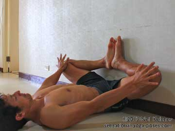 butterfly yoga pose against the wall, yoga poses, yoga poses using a wall